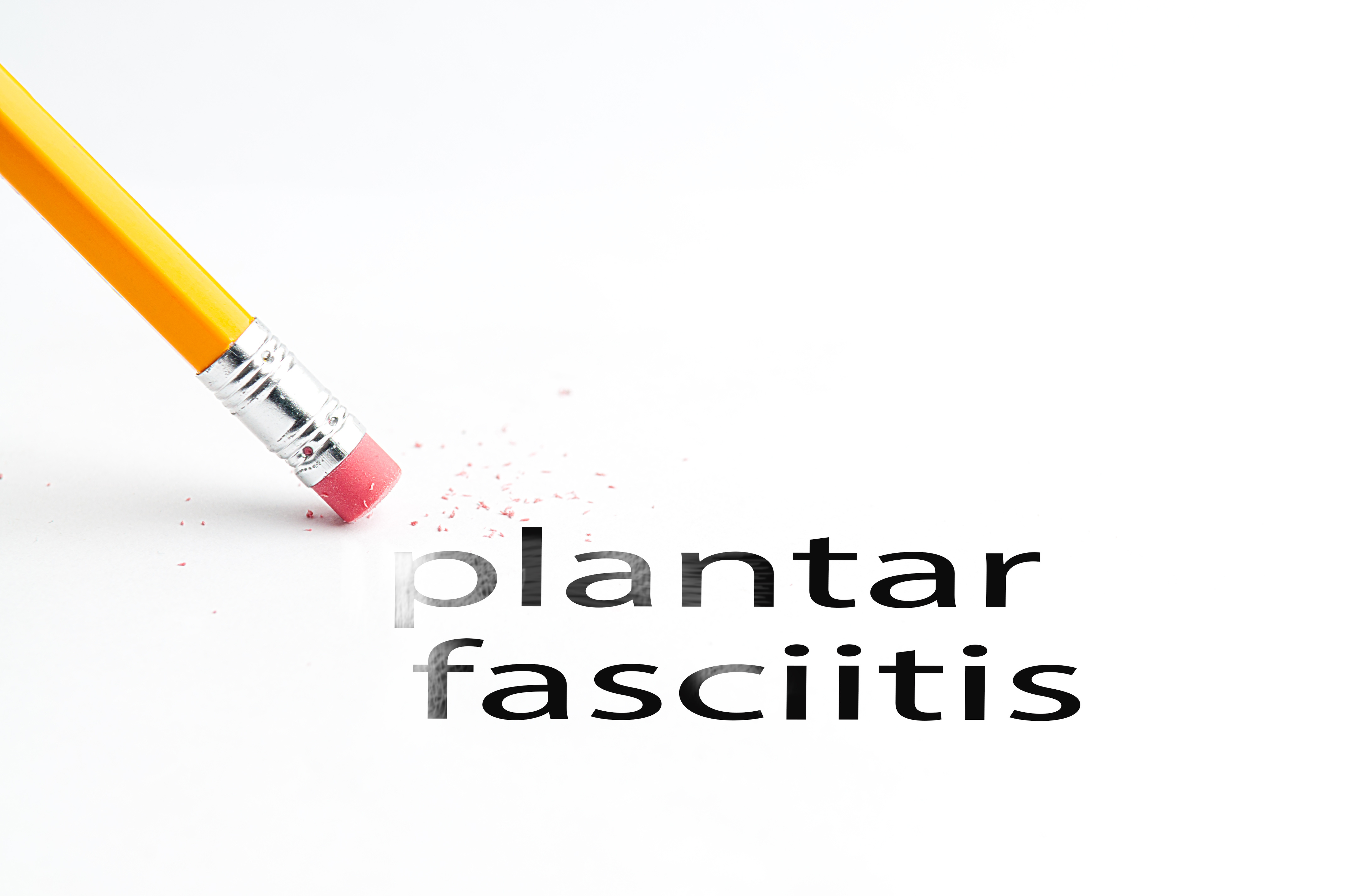 Closeup of pencil eraser and black plantar fasciitis text. Plantar fasciitis. Pencil with eraser.