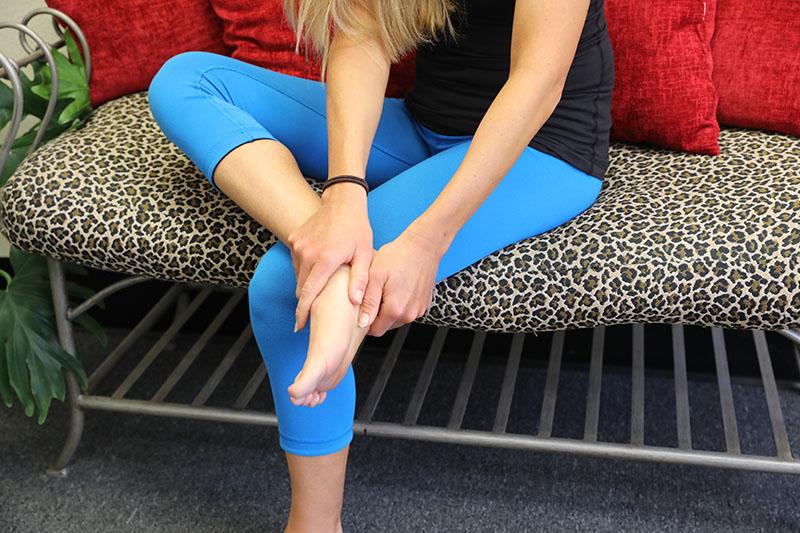 Caroline touching foot