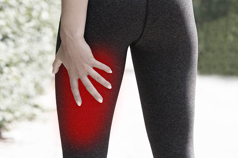 Close-up Of A Female Runner Holding His Injured Leg