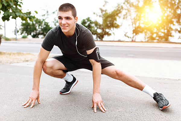 A man doing a leg stretch before Jogging, morning training