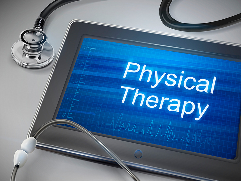 physical therapy words displayed on tablet with stethoscope over table
